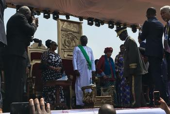 Liberia's new President George Weah (center) and former President Ellen Johnson Sirleaf (right) at the inauguration ceremony at SKD stadium in Monrovia, Liberia on 22 January 2018. Photo