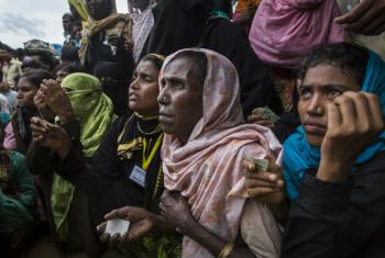 Rohingya refugees wait for food distribution in Kutupalong camp, Cox's Bazar Bangladesh.
