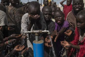 Children use a water point at the Muna Customs Camp for internally displaced persons in Maiduguri town, Borno State, Nigeria, July 2017.