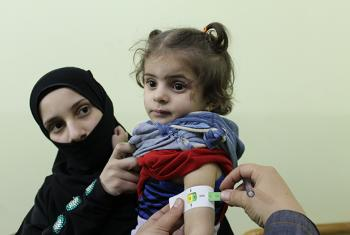 A child is measured by a health professional to determine whether she is suffering from severe acute malnutrition in Eastern Ghouta, Syrian Arab Republic, 30 October 2017. ©UNICEF/UN0142210/Tom/OCHA