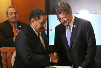 Miroslav Lajčák, the President of the General Assembly (right), receives the outcome communique from Hashim Hussein, the head of the UNIDO ITPO-Bahrain and Executive Secretary of WEIF 2017 (centre), as Samir Aldarabi, Director of UNIC-Manama looks on. (