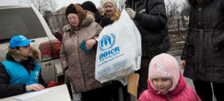 Ucranianos recebem assistência do Acnur. Foto: Acnur/A.McConnell