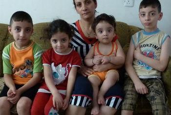 Família deixou cidade próxima a Mossul, em junho deste ano, após militantes do grupo islâmico Isil tomarem áreas da região. Foto: Irin/Louise Redvers