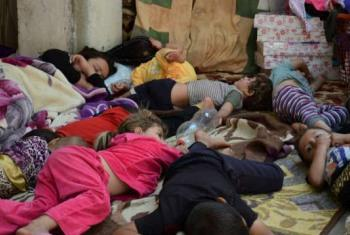 Menores da etnia yezidi aem fuga. Foto: Acnur/N. Colt