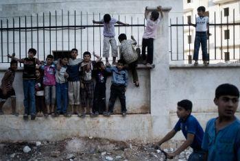 Crianças sírias em Alepo. Fotos: Unicef/Romenzi