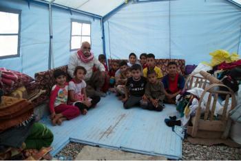 Família em acampamento no Curdistão. Foto: Ocha/Charlotte Cans