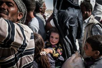 Refugiados sírios fugindo de combates perto da cidade de Kobani. Foto: Acnur/I. Prickett