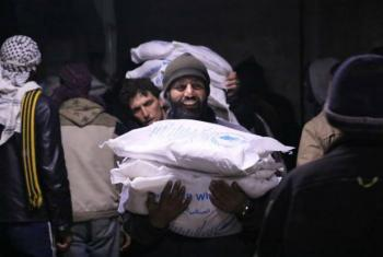 Entrega de ajuda alimentar à população síria. Foto: PMA/ Hussam Al Saleh