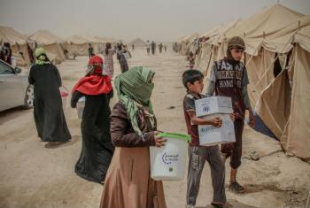Entrega de ajuda humanitária a refugiados sírios. Foto: Ocha/Themba Linden