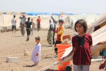 Refugiados yazidi, incluindo crianças, em campo de refugiados a 40 quilômetros da fronteira da Síria com o Iraque. Foto: Unicef/Razan Rashidi