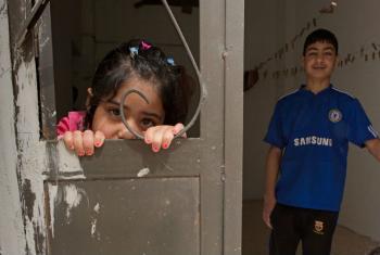 Dois irmãos refugiados sírios na Jordânia. Foto: Unicef/Lucy Lyon