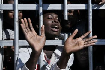 Migrante em centro de detenção na Líbia. Foto: Unicef/UN052608/Romenzi