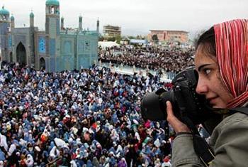 Женцина-репортер. Фото ООН